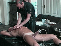 Blond hunk is splashed with hot candle wax